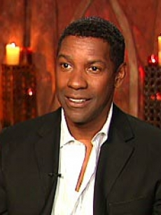 Denzel smiles during an Access interview