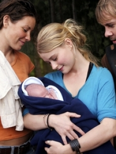 Evangeline Lilly, Dominic Monaghan, Emilie de Ravin, and baby
