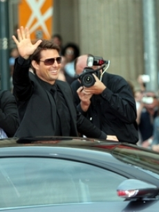 Tom Cruise arrives in the Bugatti Veyron