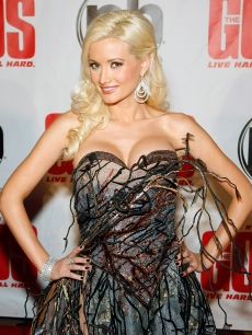 Holly Madison is frilly in feathers at the Las Vegas premiere of 'The Goods: Live Hard, Sell Hard' at the Planet Hollywood Resort & Casino in Las Vegas on August 12, 2009
