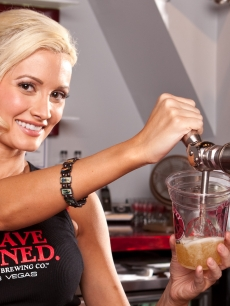 Holly Madison pulling the tap at Sin City Brewing, Co. at the Planet Hollywood in Las Vegas on August 14, 2009