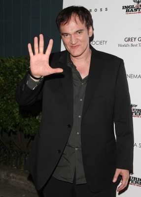 Quentin Tarantino waves on his way to The Cinema Society screening of &#8216;Inglourious Basterds&#8217; at SVA Theater in New York City on August 17, 2009 