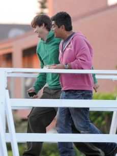 Ashton Kutcher and George Lopez pal around in Venice Beach on August 27, 2009