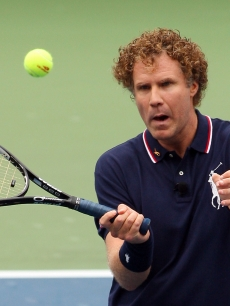 Will Ferrell hits a volley at the U.S. Open's Arthur Ashe Kid's Day at Flushing Meadows in New York on August 29, 2009