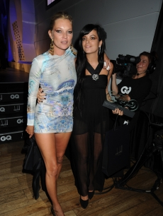 Kate Moss and Lily Allen strike a pose at the GQ Men of the Year Awards in London, Sept. 8, 2009