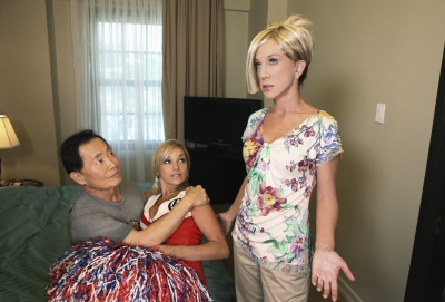 Kathy Griffin as Kate Gosselin, catches George Takei as Jon, in an embrace with a cheerleader on &#8216;Jimmy Kimmel Live,&#8217; Sept. 2009