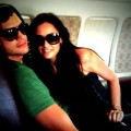 Ashton Kutcher and Demi Moore keep each other safe during a brief flight scare on August 7, 2009