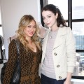 Hillary Duff and Michelle Trachtenberg pose for photograghers inside Victoria&#8217;s Secret Fashion Week Suite at the Bryant Park Hotel during New York Fashion Week in New York City on September 17, 2009