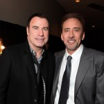 John Travolta makes a return to public life alongside Nicolas Cage at Disney's D23 Expo in Anaheim, Calif., on September 11, 2009