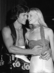 Patrick Swayze shares a laugh with his wife, dancer and actress Lisa Niemi at the premiere party for the movie &#8216;Skatetown USA&#8217; at Flippers roller rink, Los Angeles, California, October 1979