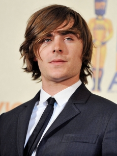 Zac Efron poses at the 2009 MTV Movie Awards Press Room at Gibson Amphitheatre on May 31, 2009 in Universal City, California