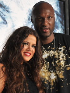 Khloe Kardashian and NBA player Lamar Odom arrives on the red carpet of the Los Angeles premiere of &#8216;Whiteout&#8217; at the Mann Village Theatre on September 9, 2009 in Westwood, Los Angeles, California