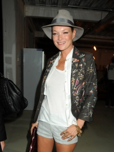 Kate Moss attends the Unique Fashion Show during London Fashion Week on September 20, 2009