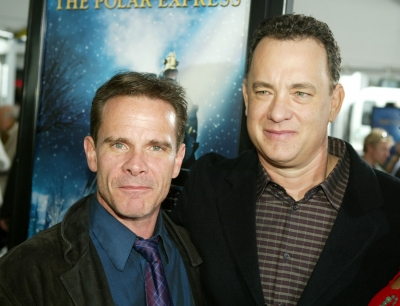 Actors Peter Scolari and Tom Hanks arrive at the premiere of 'Polar Express' and the Grauman's Chinese Theatre on November 7, 2004 in Hollywood, California