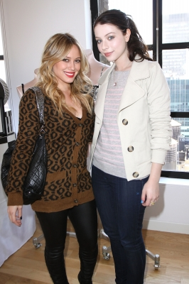 Hillary Duff and Michelle Trachtenberg pose for photograghers inside Victoria's Secret Fashion Week Suite at the Bryant Park Hotel during New York Fashion Week in New York City on September 17, 2009