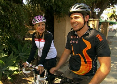 Maureen McCormicks learns proper cycling from AccessHollywood.com Managing Editor Jeremy Blacklow