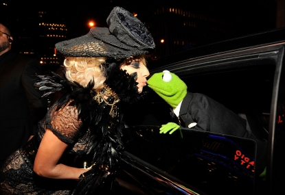 Lady Gaga and Kermit the Frog share a kiss at the 2009 MTV Video Music Awards at Radio City Music Hall on September 13, 2009 in New York City