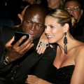 Seal and Heidi Klum take their photo with an iPhone during the Emmy Awards, Los Angeles, Sept. 20, 2009