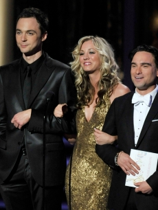 Jim Parsons, Kaley Cuoco, and Johnny Galecki present the Outstanding Directing/Writing for a Variety, Music, or Comedy Series awards onstage during the 61st Primetime Emmy Awards held at the Nokia Theatre, LA, September 20, 2009