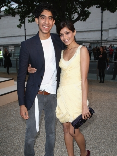 Dev Patel and Freida Pinto attend the Burberry show at London Fashion Week, Sept. 22, 2009