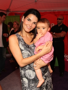 Angie Harmon and her daughter Emery Hope Sehorn attend Huggies Little Movers Adventure Zone And Live Auction at Madison Square Park on September 22, 2009