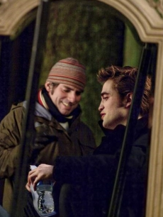 Director Chris Weitz and Robert Pattinson talk during scene blocking on the 'New Moon,' set on April 23, 2009