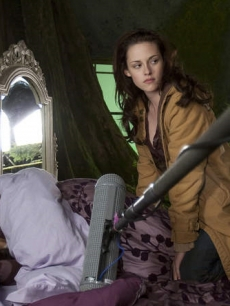 Kristen Stewart readies herself for a scene during a dream sequence in 'New Moon,' leaning over her camera double Mikayla Henderson