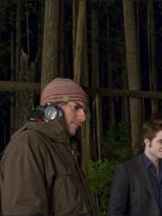 'New Moon' Director Chris Weitz and a smiling Robert Pattinson on the set just outside Vancouver on April 24, 2009
