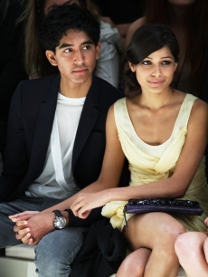 Dev Patel and Freida Pinto hold hands at the Burberry Prorsum Spring/Summer 2010 Show during London Fashion Week on September 22, 2009 in London, England