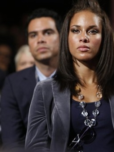Alicia Keys listens intently as she sits in front of Jessica Alba, Cash Warren and Fergie as President Barack Obama speaks at the Clinton Global Initiative Annual meeting in New York on September 22, 2009