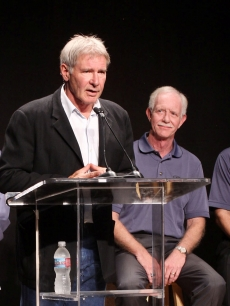 Harrison Ford introduces hero pilot 'Sully' Sullenberger, his replacement as EAA Young Eagles Chairman, in Santa Monica, California on September 29, 2009