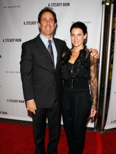 Jerry Seinfeld and wife Jessica Seinfeld pose for photographers at the 'A Steady Rain' Broadway opening night in New York City on September 29, 2009