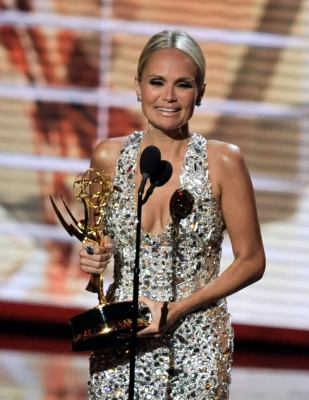 Kristin Chenoweth accepts the Outstanding Supporting Actress in a Comedy Series award for &#8216;Pushing Daisies&#8217; onstage during the 61st Primetime Emmy Awards, Los Angeles, September 20, 2009