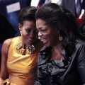 Michelle Obama shares a laugh with Oprah Winfrey at the opening Ceremony of the 121st IOC Session in Copenhagen, Denmark on October 1, 2009
