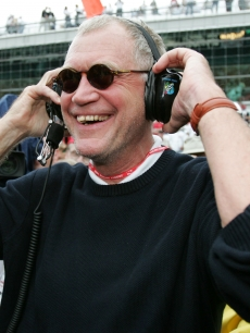 David Letterman, co-owner of the #15 Rahal-Letterman ArgentPioneer G Force Honda of Buddy Rice, smiles when the rain started to fall and cause the race to be shortened and Rice to win the 88th running of the Ind
