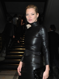 Kate Moss channels her inner rocker in a black leather dress at the Miu Miu Pret a Porter show in Paris, France on October 7, 2009