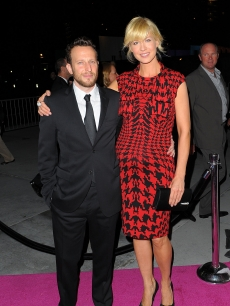 A very pregnant Jenna Elfman and her husband Bodhi Elfman pose for cameras at the Inaugural Gala of the Los Angeles Philharmonic at the Walt Disney Concert Hall in Los Angeles on October 8, 2009