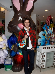 British pop singer Mika visits Dylan's Candy Bar, where he poses in front of a giant chocolate bunny, NYC, Oct. 16, 2009
