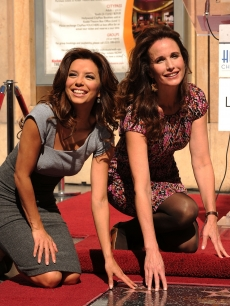 Eva Longoria Parker and Andie MacDowell are all smiles at the ceremony celebrating L&#8217;Oreal&#8217;s 100th anniversary with a star on The Hollywood Walk Of Fame on October 20, 2009 in Hollywood, California