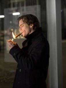 Matt Bomer lights a cigar during an episode of 'White Collar'