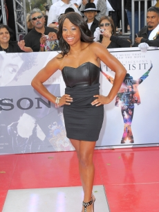 Former 'HSM' star Monique Coleman poses on the red carpet at the LA premiere of 'This Is It,' Oct. 27, 2009