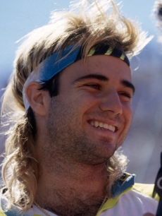 Andre Agassi talks to the media during the 1990 U.S. Open held in September 1990 at Flushing Meadows, in New York