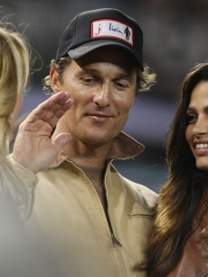 Matthew McConaughey and girlfriend Camila Alves look on during Game One of the 2009 MLB World Series at Yankee Stadium on October 28, 2009