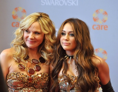 Kim Cattrall and Miley Cyrus on the set of &#8216;Sex and the City 2&#8217; in New York City on October 16, 2009