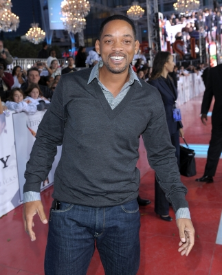 Will Smith smiles before heading into the premiere of 'This Is It,' Los Angeles, Oct. 27, 2009