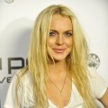 Lindsay Lohan poses for a picture at Jermaine Dupri and Pascal Mouawad's Nu Pop Movement launch party held at Kitson Men's on November 12, 2009 in West Hollywood, California