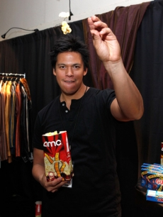 Chaske Spencer gets his popcorn arm ready with AMC Theatres for the premiere of 'New Moon'