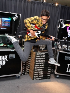 Mark Indelicato of 'Ugly Betty' shows off his moves with Guitar Hero 5