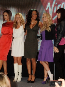 Spice Girls members Victoria Beckham, Geri Halliwell, Melanie Brown, Emma Bunton and Melanie Chisholm pose as they open Virgin Atlantic's new terminal at Heathrow, on December 13, 2007