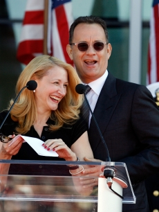 Patricia Clarkson and Tom Hanks share a laugh during the National World War II Museum Dedication Ceremony in New Orleans, Louisiana on November 6, 2009